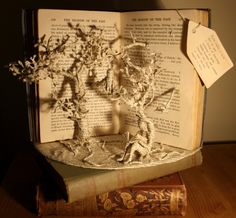 """Paper Sculptures """"From within a book"""" Amazing book sculptures created by Emma Taylor. She carefully chooses each book she turns into a piece of art. With her careful hand, she brings out the story literally in the form of cut out pages of the book."""