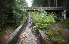The disused bobsleigh track from the Sarajevo 1984 Winter Olympics is seen on Mount Trebevic, near Sarajevo. Abandoned and left to crumble into oblivion, most of the 1984 Winter Olympic venues in Bosnia's capital Sarajevo have been reduced to rubble. Super Creepy Pictures Of Forgotten Olympic Villages