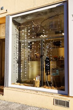 A butterfly window shop in Prague by Kreativni matka