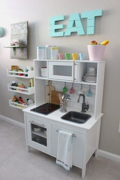 ikea hack diy kid play kitchen playroom design, kid playroom decor ideas, playroom organization for kid room, kid room decor Using baskets to organize toys in a playroom. hacks kids playroom 15 IKEA Toys Ideas Every Parent Should Know - mybabydoo