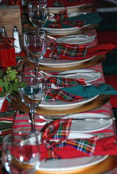 """So simple.... Just get plaid ribbon roll to make your napkin """"rings""""... You could add a personalized ornament  hanging from the ribbon as a favor!"""