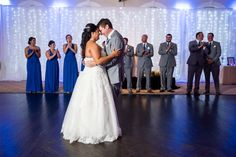 An illuminated curtain backdrop can help transform the dancefloor at your wedding