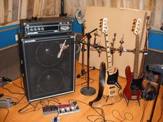 "my precious.    1972 Acoustic Control Corp model 370 amp head, 1973 Acoustic Control Corp.  model 106 (2-15"") cabinet.  2011 Squier VM jazz,   20?? Squier Standard P/J,   Boss ME20b multi-fx,   Eventide Space Delay."