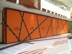 This bold orange Hermes barricade was once housed at the Shops at Riverside    For more information on Center Stage barricades, visit: www.cspdisplay.com/barricades
