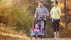 Buy Young family running by halfpoint on PhotoDune. Beautiful young family with baby in jogging stroller running outside in autumn nature Running With Stroller, Jogging Stroller, Running In The Dark, Post Pregnancy Workout, Pregnancy Fitness, Beachbody Blog, It Band, Young Family, Running Workouts