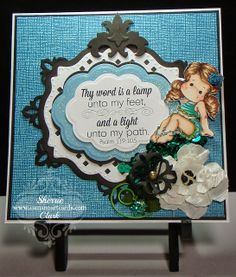Thy word is  lamp unto my feet.............by Camano Art Cards.  Magnolia Sea Breeze Collection Bikini Tilda colored with Copic Markers.  Accessories: Spellbinders: Damask Accents, Lattice Motifs, Big Scalloped Ovals Small, and Rose Creations. Now this is Camano Island Living!