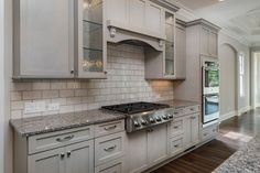 New Construction Custom Kitchen Design.  Details: Maple Cabinetry with semi-transparent gray stain, white subway tile with contrasting charcoal grout and granite countertops.  Client:  Bluefield Builders Charlotte, NC a franchise of Arthur Gutenberg Homes.