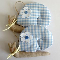 Puffy hanging snails in light blue checked fabric by paninohome