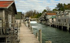Historic Fishtown in Leland Michigan is Fishtown is a collection of weathered fishing shanties, smokehouses, overhanging docks, fish tugs and charter boats along the Leland River in Leland, Michigan. The heart of a commercial fishing village, Fishtown is where we can still see and feel a connection to the long tradition of Great Lakes maritime culture.  Find out more at www.fishtownmi.org or www.lelandmi.com