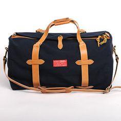 Navy and canvas weekender bag