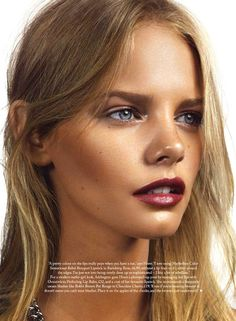 Sun-kissed glow with a deep red lip // Photo: Jonas Bresnan for Marie Claire UK