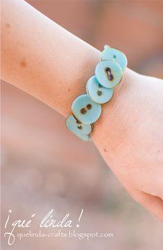tutorial here:   http://quelinda-crafts.blogspot.com/2012/01/button-bracelet.html