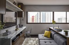 Multifunctional apartment in Brazil fits three rooms into one. See more at http://humble-homes.com/bep-architects-versatile-furniture-small-spaces/