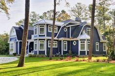 lovely navy blue with white trim, I think this is called a Cape Cod style home