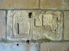 Old graffiti, St Giles' Church, Imber The graffiti is to be found in the north porch of the church. It was probably done by bored curates.