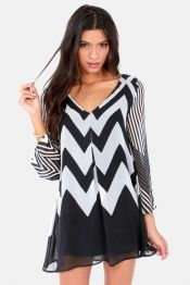 """The Wake Me Up Ivory and Black Chevron Print Dress may look like a dream, but a little pinch will prove it's actually a dream come true! A vivacious V neck with a single pleat below starts off right, with black and ivory chevron stripes that grow larger on their way down a wide-cut A line bodice to all black at the hem. Sheer, long bell sleeves boast some style of their own, with varying gradients of black and ivory stripes and chevron print. Body of dress is lined. Model is 5'10"""" and is…"""
