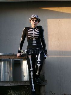 Skeleton costume.  I would add a red sequin heart over the breast.