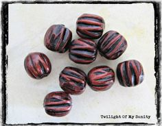 Handmade polymer clay beads - 9 carved barrel beads - Copper and black color