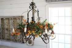 Beautiful chandelier arrangement from Joanna Gaines blog - http://magnoliahomes.net/blog/page/2/