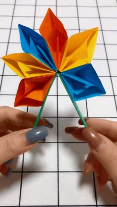 DIY handmade origami crafts fan DIY Origami Gifts & DecorationMaster the basics of Origami while giving them purpose Instruções Origami, Paper Crafts Origami, Diy Paper, Paper Crafting, Hanging Origami, Origami Ring, Rainbow Origami, Origami Videos, Origami Boxes