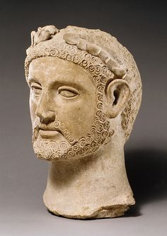 Terracotta head of a man wearing a wreath  ca 400-310 BC  Cypriot