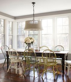 A few $4 cans of spray-paint woke up sedate thrift-store Windsors, each between $15 and $35, in this Oregon home's dining room. The homeowner bought the Pottery Barn burlap lamp on clearance. - CountryLiving.com