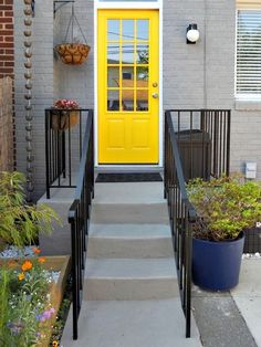 painted grey brick + yellow door Sherwin Williams Classic French Gray. Maybe a little bright for the door