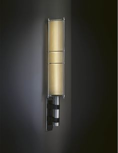 Price above excludes VAT The bold lines and dramatic scale of the Arbor Wall Light create a compelling statement. Clear acrylic rods and machined solid brass lend weight to the eye-catching design which commands attention in any space. Specification: H:750mm W:170mm
