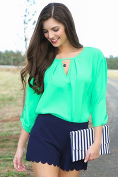 This stunning, kelly green blouse is everything you have ever wanted & more! Perfect for a day or night out on the town & St. Patty's Day!