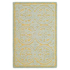 Featuring a textured medallion motif in blue and gold, this hand-tufted wool rug adds an ornate touch to your living room or master suite. ...