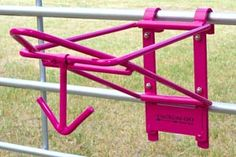 Fold down Saddle and Bridle Rack! In pink and Black from Tack-n-Go! Just what I needed for my Trailer.