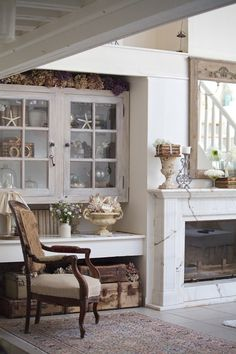 The well-loved look of this room, the mixing of woods and materials, and the subtle beachy details all combine to give it that seaside-escape feel.