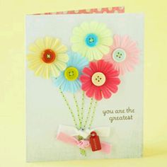 Card using flowers, buttons, tags and ribbon