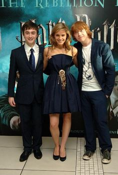 Harry Potter trio. Emma's dress is so pretty! She's wearing a  a Chanel Outpouring 2006 Couture Varied Prepare, matched with Religionist Louboutin Necked Leather Shoe.