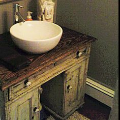 Old desk as powder room sink. Awesome!