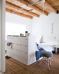 Bedroom With Knitted Stool And White Closet