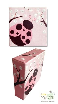 """Ladybug on canvas. 1-1/2"""" profile with tree branches and white flowers that continue onto a dark pink background."""