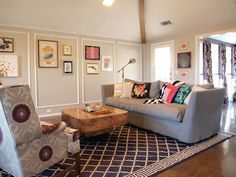 Navy Moroccan rug, purple suzani chairs, gallery wall, burl wood coffee table in our living room