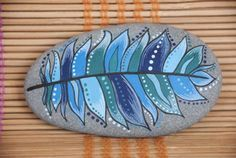 Painted Stone Blue Feather hand painted rock blue feather. 30+ Easy Rock Painting Ideas For Fun | Childern | Kids | Art #rock #painting #paintart #fun