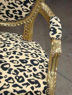 My M-I-L has a chair similar to this and I love it. Hers is leopard print. I love a splash of animal print in decorating. Probably because it's a dream to go on a safari.