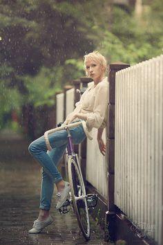 Girl on bicycle in the rain...
