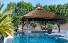 Pool bar perfectly shaded with a thatch gazebo! #Gazebo #PoolBar #Pool #Outdoor
