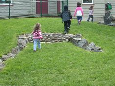 tiny stone retaining wall for toddlers to play on