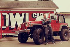 Cool-boy-senior-pictures-of-football-player-with-his-jeep-at-Studio-B-Portraits.jpg (900×600) (by the town sign)