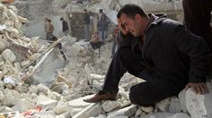 A man crying at rubble after fighting in Syria