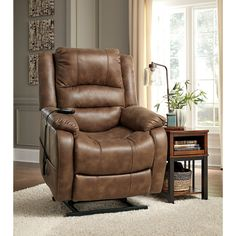 yandel saddle power lift recliner by signature design by ashley get your yandel saddle power lift recliner at owenu0027s home furnishings