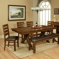"""This dining set is a beautiful two-tone natural and black acacia wood dining table.  It features a natural finished top with antique distressed table base and sides.  The table is 70"""" long alone and has two end leaves to extend this table to 96"""" for a lot of entertaining!  This set includes 6 corresponding chairs that have the same antique black distressed finish and a brown faux leather with nailhead trim.  The Vineyard 8 piece Dining Set"""