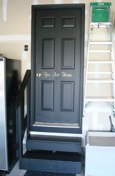 LOVE the black door! Our white one is constantly dirty! Black railings and stairs, too!