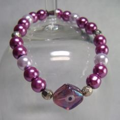Pale Lilac and Mauve Glass Pearls with Silver-tone and Lampwork Feature Beads, Stretchy Bracelet - £4.50 at http://jewellerybyrebecca.co.uk/gpb004