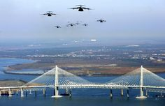 17 C-17 jets fly over the Ravenel Bridge during a training mission on Dec. 20, 2005. By Alan Hawes/The Post and Courier.